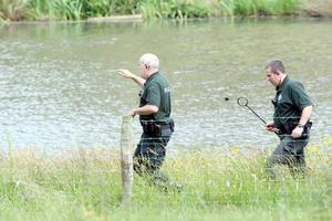 Police search a lake in Castlerock at the back of dentist's Colin Howells former house on The Glebe Road.  June 2009