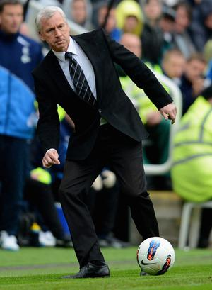 NEWCASTLE UPON TYNE, ENGLAND - APRIL 09: Newcastle manager Alan Pardew kicks the ball during the Barclays Premier League match between Newcastle United and Bolton Wanderers at the Sports Direct Arena on April 9, 2012 in Newcastle upon Tyne, England.  (Photo by Michael Regan/Getty Images)