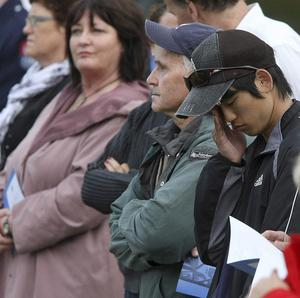 The memorial service saw 10,000 people stand in silence, some in tears, one year on from the devastating quake which rocked Christchurch (AP)