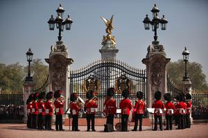 LONDON, ENGLAND - APRIL 20: The Band of the Coldstream Guards form up around the main gate of   Buckingham Palace during the Changing of the Guard ceremony on April 20, 2011 in London, England. Soldiers guard Queen Elizabeth II and other royals at Buckingham Palace in a 24 hour rotation with a ceremonial hand over at 11.30 in the morning.  (Photo by Peter Macdiarmid - WPA Pool /Getty Images)