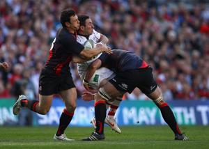 DUBLIN, IRELAND - APRIL 28:  Paddy Wallace of Ulster is tackled during the Heineken Cup semi final match between Ulster and Edinburgh at Aviva Stadium on April 28, 2012 in Dublin, Ireland.  (Photo by Warren Little/Getty Images)