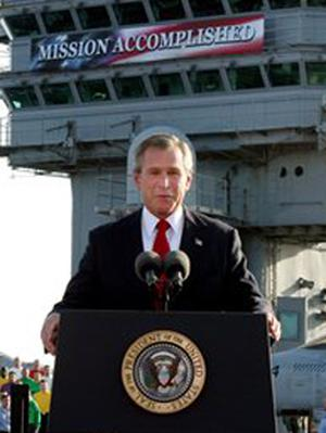 Bush declaring the end of major combat in Iraq on May 1, 2003