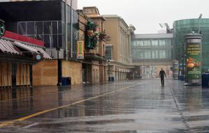 ATLANTIC CITY, NJ - OCTOBER 28:  A man walks past boarded up structures on the boardwalk ahead of Hurricane Sandy on October 28, 2012 in Atlantic City, New Jersey.  Governor Chris ChristieÄôs emergency declaration is shutting down the cityÄôs casinos and 30,000 residents are being told to evacuate.    (Photo by Mario Tama/Getty Images)