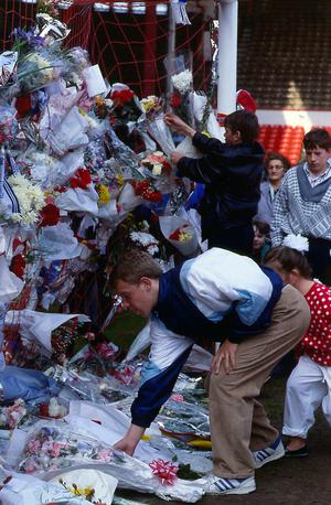 Anfield fans leave flowers in the nets