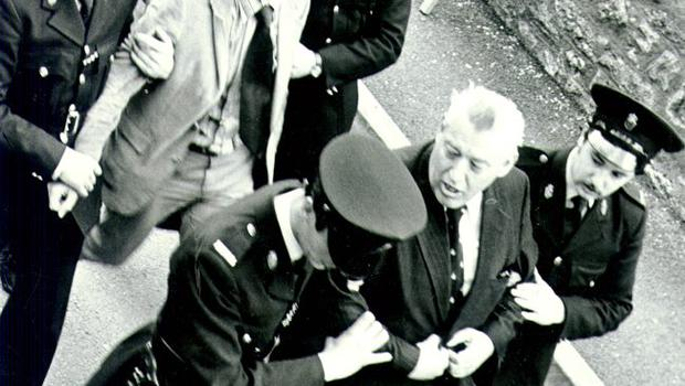 Ian Paisley and Peter Robinson being arrested in Armagh.1980