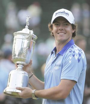 Rory McIlroy, of Northern Ireland, poses with the trophy after winning the U.S. Open Championship golf tournament in Bethesda, Md., Sunday, June 19, 2011