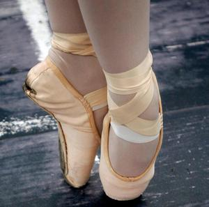 Experts have warned that ballet shoes put pressure on the knees, hip and back