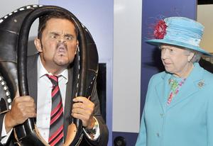 Britain's Queen Elizabeth II watches the antics of Tommy Mattinson, the world Gurning champion, during a visit to Whitehaven, England, Thursday June 5 2008.(AP Photo)