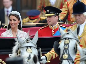LONDON, ENGLAND - APRIL 29:  Their Royal Highnesses Prince William, Duke of Cambridge and Catherine, Duchess of Cambridge prepare to begin their journey by carriage procession to Buckingham Palace following their marriage at Westminster Abbey on April 29, 2011 in London, England. The marriage of the second in line to the British throne was led by the Archbishop of Canterbury and was attended by 1900 guests, including foreign Royal family members and heads of state. Thousands of well-wishers from around the world have also flocked to London to witness the spectacle and pageantry of the Royal Wedding.  (Photo by Pascal Le Segretain/Getty Images)