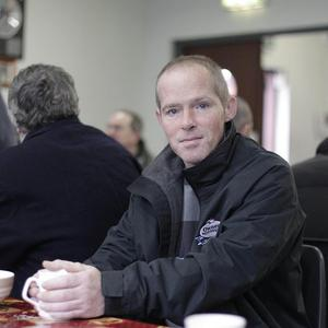 Homeless man Noel Fagan has a coffee after picking up a food parcel at a day centre