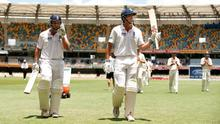 England's Jonathan Trott and Alastair Cook leave the field after putting on a massive stand of 329 in the opening Ashes test against Australia, leaving Aussie captain Ricky Ponting concerned about his side's bowling