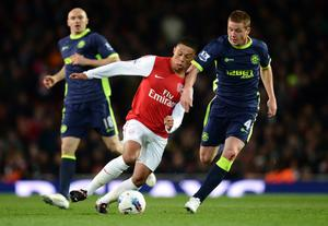 LONDON, ENGLAND - APRIL 16:  Alex Oxlade-Chamberlain of Arsenal is closed down by James McCarthy of Wigan during the Barclays Premier League match between Arsenal and Wigan Athletic at Emirates Stadium on April 16, 2012 in London, England.  (Photo by Laurence Griffiths/Getty Images)