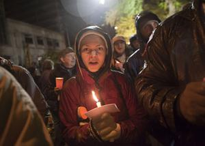 PORTLAND, OR - NOVEMBER 13: A young woman sings songs and holds a candle in support of the Occupy Portland camp November 13, 2011 in Portland, Oregon.  In spite of an eviction notice for early Sunday morning, Portland police delayed closing two downtown parks early today as thousands of people converged to support the Occupy Portland movement.  (Photo by Natalie Behring/Getty Images)