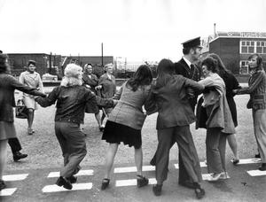 Police move a line of women demonstrators from the path of the trade unionists 'Back to Work' march to Castlereagh Industrial Estate in Belfast.  23/5/1974