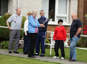 Press Eye - Belfast - Northern Ireland - 10th July 2011 - Picture by Jonathan Porter/ PressEye.com -  Overnight trouble in Ballyclare between loyalist rioters and the PSNI.  The trouble started late on Saturday night and continued into Sunday morning with a number of vehicles being highjacked and burnt out.  Local residents picturted in the Grange Estate off the Doagh Road where most of the trouble occurred.