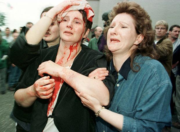 An injured woman is led away, Drumcree July 1997