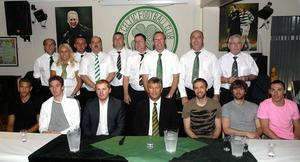 Lurgan Celtic Supporters' Club committee pictured with Celtic players, chief executive Peter Lawwell and manager Neil Lennon