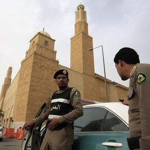 Saudi policemen form a checkpoint outside Al Rajhi mosque where a demonstration was expected to take place (AP)