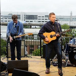 Blur perform from a balcony at a secret location in a live show via Twitter
