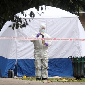 Forensics officers at the scene of a stabbing near Stansfield Road in the Beckton area of east London, in which a woman was killed