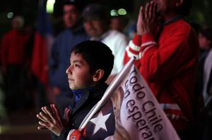 A boy gestures as he watches on TV the rescue operations at the San Jose mine to free 33 trapped miners in Copiapo, Chile, late Tuesday Oct. 12, 2010.  Thirty-three miners became trapped when the gold and copper mine collapsed on Aug. 5. (AP Photo/Dario Lopez-Mills)