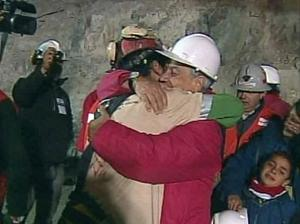In this screen grab taken from video, Florencio Avalos, the first miner to be rescued, left, is embraced by Chilean President Sebastian Pinera after his rescue at San Jose Mine near Copiapo, Chile. (AP Photo)
