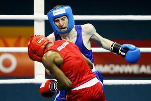 Paddy Barnes of Northern Ireland (blue) competes against Jafet Uutoni of Namibia (red) in the Light Fly Weight (46-49kg) Men Finals Gold Medal Bout at Talkatora Indoor Stadium on day ten of the Delhi 2010 Commonwealth Games on October 13, 2010 in Delhi, India