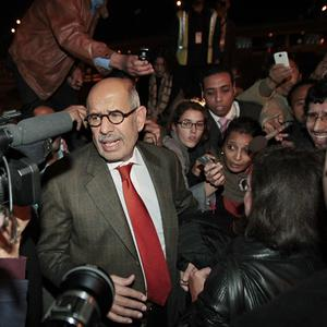 Former director general of the International Atomic Energy Agency and Nobel Peace Prize winner Mohamed ElBaradei arrives at Cairo Airport (AP)