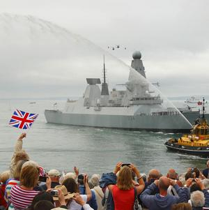 HMS Diamond enters Portsmouth Harbour after firing a 21 gun salute to officially launch celebrations to mark the Queen's Diamond Jubilee