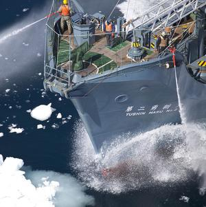The crew of Japanese whaling ship Yushin Maru No 2 readies their water cannons to engage with Sea Shepherd in the Southern Ocean off Antarctica (AP)