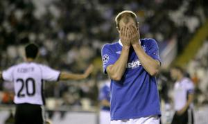 Rangers's player, Steven Whittaker from Scotland, reacts during the Group C Champions League soccer match against Valencia at the Mestalla Stadium in Valencia, Spain, Tuesday, Nov. 2, 2010. (AP Photo/Fernando Bustamante)