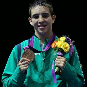Michael Conlan with his bronze medal at the medal ceremony for the Olympic Games at the ExCeL, London