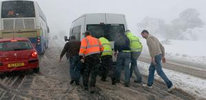 Workmen push their van after getting stuck in snow on the Glenshane Pass.. 30.3.10
