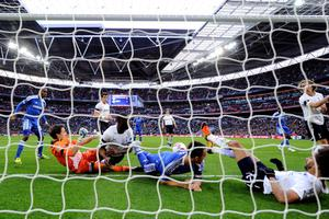LONDON, ENGLAND - APRIL 15:  Goalmouth scramble involving Carlo Cudicini of Tottenham Hotspur, Ledley King of Tottenham Hotspur, John Terry of Chelsea and Benoit Assou-Ekotto of Tottenham Hotspur as Juan Mata of Chelsea (not pictured) scores their second gaol during the FA Cup with Budweiser Semi Final match between Tottenham Hotspur and Chelsea at Wembley Stadium on April 15, 2012 in London, England.  (Photo by Mike Hewitt/Getty Images)