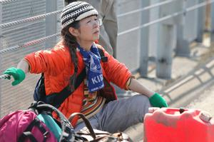 SENDAI, JAPAN - MARCH 14:  A local resident rests as she evacuates an area after a 9.0 magnitude strong earthquake struck on March 11 off the coast of north-eastern Japan, on March 14, 2011 in Sendai, Japan. The quake struck offshore at 2:46pm local time, triggering a tsunami wave of up to 10 metres which engulfed large parts of north-eastern Japan. The death toll is currently unknown, with fears that the current hundreds dead may well run into thousands.  (Photo by Kiyoshi Ota/Getty Images)