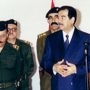 Abed Hamid Hmoud, seen standing behind Saddam Hussein, who has been executed in Iraq (AP)