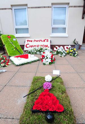 Tribute and Flowers left at the sister of snooker legend Alex Higgins, house in Iverna Close in Belfast ahead of his funeral