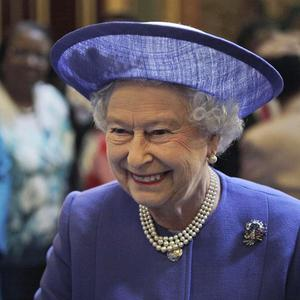 The Queen talks with dignitaries during a lunch with Commonwealth heads of government and representatives of the Commonwealth nations