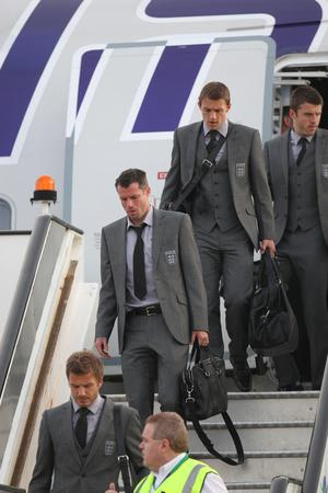 England's ambassador David Beckham, Jaime Carragher and Stephen Warnock arrive at Heathrow Airport, London. The England team returned to the UK after a 4-1 defeat to Germany in the Round of 16 match in Bloemfontein, South Africa on Sunday
