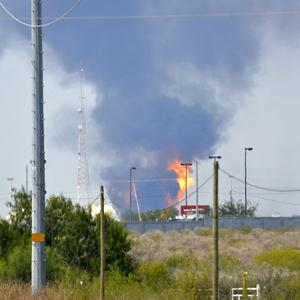 Fire and smoke rise from a gas pipeline distribution centre in Mexico (AP)
