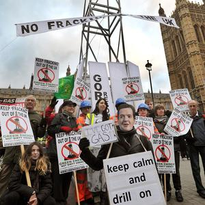 Demonstrators erected a 7m high 'fracking rig' as they call for a ban on fracking in the UK