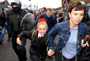 Parents escort their children to Holy Cross Girls' Primary School during a Loyalist protest in 2001. Picture by Justin Kernoghan
