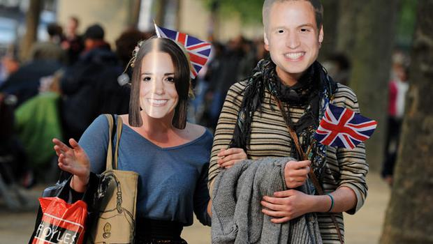 LONDON, ENGLAND - APRIL 28:  A couple strolls the Mall while wearing Prince William and Catherine Middleton masks ahead of tomorrow's marriage ceremony of Prince William and Catherine Middleton in Westminster Abbey on April 28, 2011 in London, England. With less than 24 hours to go final preparations for the wedding of Prince William and Catherine Middleton are in place.  (Photo by Jasper Juinen/Getty Images)
