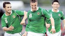 Smiles better: Northern Ireland's James Gray celebrates one of his goals with Chris Hegarty.