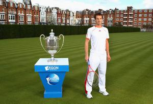 LONDON, ENGLAND - APRIL 10:  Andy Murray of Great Britain poses with the AEGON Championships Trophy on the day that he committed playing at the Queen's Club for the next five years. Murray was at a tournament launch for the AEGON Championships at the Queen's Club on April 10, 2012 in London, England.  (Photo by Julian Finney/Getty Images for The LTA)