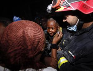 Two year old Redjeson Hausteen Claude reacts to his mother Daphnee Plaisin after he is rescued