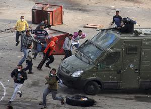 Egyptian protesters clash with riot police in Suez, Egypt Thursday, Jan. 27, 2011. Egyptian activists protested for a third day as social networking sites called for a mass rally in the capital Cairo after Friday prayers, keeping up the momentum of the country's largest anti-government protests in years. (AP Photo)