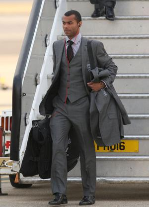 England's Ashley Cole arrives at Heathrow Airport, London.  The England team returned to the UK after a 4-1 defeat to Germany in the Round of 16 match in Bloemfontein, South Africa on Sunday