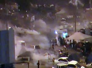 In this image from video riot police firing tear gas and wielding clubs storm Pearl Square occupied by anti-government protesters before dawn Thursday, Feb. 17, 2011 driving out demonstrators and destroying a makeshift encampment that had become the hub for demands to bring sweeping political changes to the kingdom. (AP Photo/Tony Mitchell, HO)
