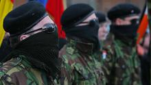 Masked INLA members attend a republican parade in Londonderry in  2007